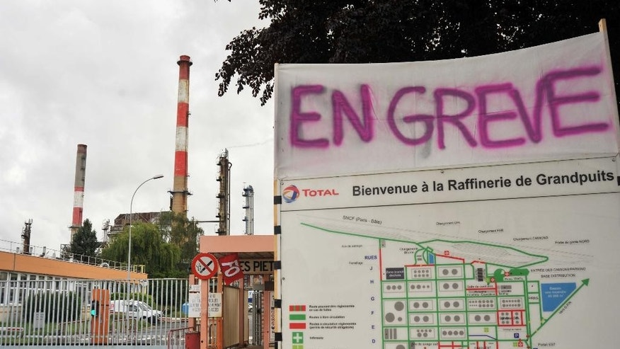 "A banner reading in French ""On strike"" is pictured at the main entrance of the Grandpuits refinery where workers voted to strike in Grandpuits, east of Paris, France, Monday, May 23, 2016. The union-led blockade, one of several set up at refineries and depots across France, is aimed at securing the withdrawal of the country's labor reforms, which hopes to inject new life into the country's rigid labor market. (AP Photo/William Wilson Lewis III)"