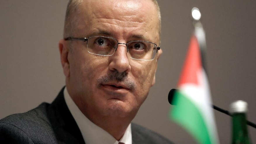 "FILE -- In this April 21, 2015 file photo, Palestinian Prime Minister Rami Hamdallah pauses during a press conference on the sideline of Asian African Conference in Jakarta, Indonesia. A new poll signals that almost all Palestinians in the West Bank now believe there is corruption in the government of President Mahmoud Abbas. Hamdallah said his government is vigilant about stamping out any corruption. Suspicions of serious wrongdoing have been rare, but suspects ""will be brought to justice,"" he said at a recent news conference for foreign journalists. (AP Photo/Dita Alangkara, File)"