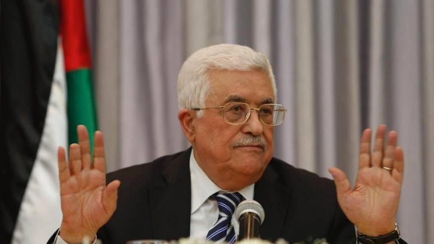 FILE -- In this Jan. 6, 2016 file photo, Palestinian President Mahmoud Abbas, also known as Abu Mazen, gestures as he speaks during a press conference, in the West Bank city of Bethlehem. A recent poll found that almost all Palestinians _ 95.5 percent _ believe there is corruption in Abbas' government. Nader Said, a veteran pollster, surveyed 1,200 people in the West Bank and Gaza Strip last month. (AP Photo/Majdi Mohammed, File)