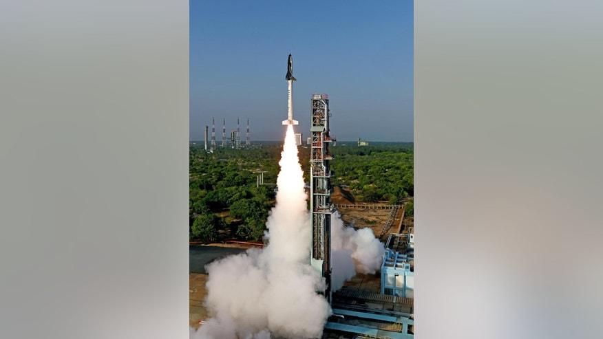 In this photo released on Monday, May 23, 2016, by an official website of the Indian Space Research Organization, India's first indigenously made and reusable space launch vehicle is seen lifted off from the launch pad at Satish Dhawan Space Center in Sriharikota, in the southern Indian state of Andhra Pradesh. India successfully flight tested a model Re-usable launch Vehicle technology Demonstrator or RLV-TD in its bid to develop reusable spacecraft. (Indian Space Research Organization via AP)