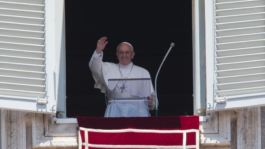 Pope Francis delivers his blessing during the Angelus noon prayer he celebrated from the window of his studio overlooking St.Peter's Square, at the Vatican, Sunday, May 22, 2016. Francis, addressing tens of thousands of tourists and pilgrims in St. Peter's Square Sunday, expressed his hopes for an humanitarian summit opening the next day in Istanbul. (AP Photo/Andrew Medichini)