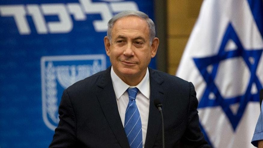 Israeli Prime Minister Benjamin Netanyahu, looks on during a faction meeting at the Knesset, Israel's parliament in Jerusalem, Monday, May 23, 2016. Israel's leader on Monday reiterated his support for the establishment of a Palestinian state, seeking to persuade critics that he remains committed to peace as he prepares to bring a polarizing hardliner into his Cabinet. (AP Photo/Sebastian Scheiner)