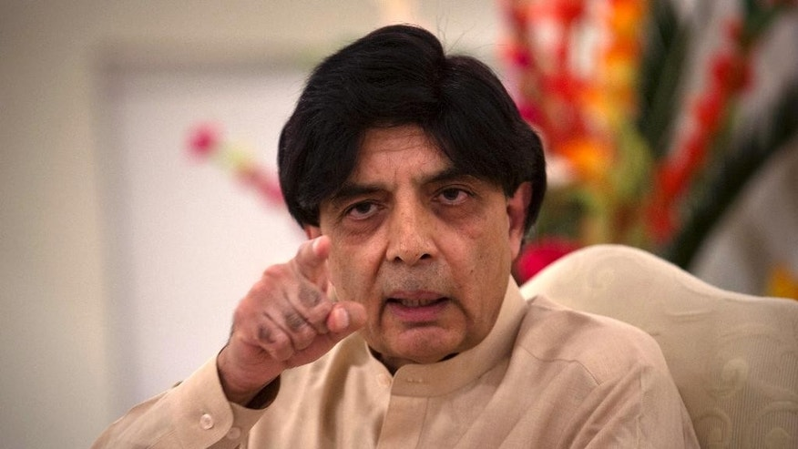 Pakistan's Interior Minister, Chaudhry Nisar Ali Khan addresses a news conference in Islamabad, Pakistan, Tuesday, May 24, 2016. Khan said authorities will perform DNA tests on the body of a man who was killed in an American drone strike to determine whether the slain man is actually Taliban chief Mullah Mohammed Akhtar Mansour. Khan also condemned the drone strike, calling it a violation of Pakistan's sovereignty. (AP Photo/B.K. Bangash)