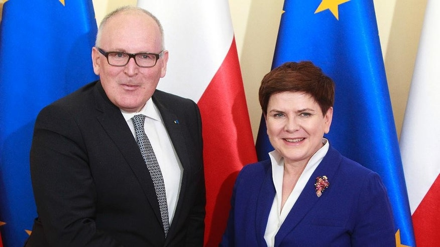 Poland's Prime Minister Beata Szydlo, right, and EU Commission Vice President Frans Timmermans, left, shake hands and smile before holding crucial talks on ways of ending Poland's political conflict that has strained ties with Brussels, at Szydlo's office in Warsaw, Poland, on Tuesday, 24 May 2016. Alarmed by government moves that have paralysed the Constitutional Tribunal, the EU Commissions has threatened sanctions if the political conflict is not solved. Timmermans' meeting with Szydlo suggests that progress has been made in finding a solution. (AP Photo/Czarek Sokolowski)