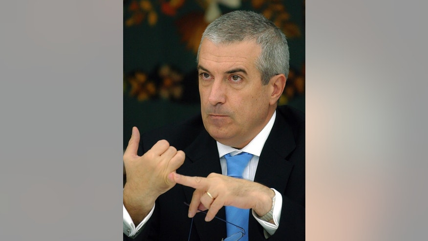 FILE - In this Monday, Oct. 31, 2005 file photo, Romanian Premier Calin Popescu Tariceanu gestures during a meeting with foreign correspondents in Bucharest, Romania. Anti-corruption prosecutors said Tuesday, May 24, 2016 that Calin Popescu Tariceanu, prime minister from 2005-2008, had made false statements under oath, denying he knew about connections between a politically-connected businessman and others with Prince Paul Philippe, hampering the investigation. (AP Photo/Vadim Ghirda, File)