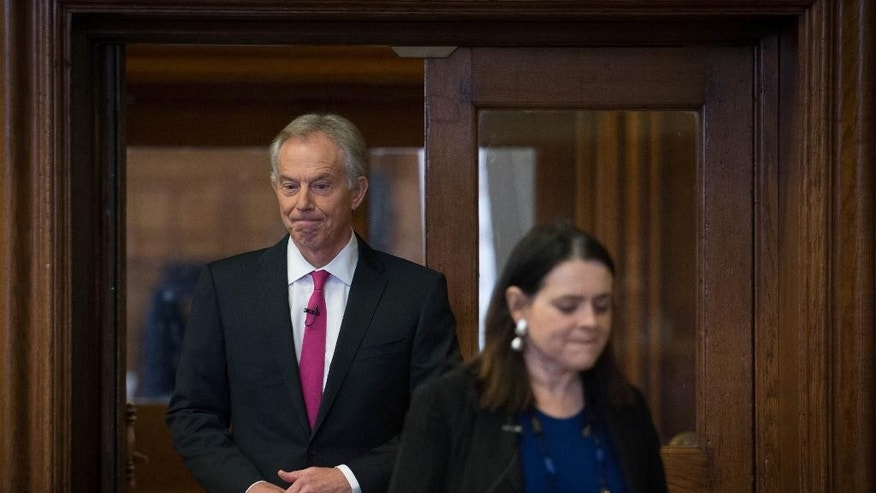 "Former British Prime Minister Tony Blair arrives with Prospect Magazine editor Bronwen Maddox, to take part Former in a discussion on Britain in the World, in London, Tuesday May 24, 2016, where he acknowledged the invading nations had underestimated the ""forces of destabilization"" that would emerge in Iraq after the toppling of dictator Saddam Hussein.  Blair said Tuesday that the Islamic State group forces will be defeated only with a ground war involving Western troops. (Stefan Rousseau / PA via AP) UNITED KINGDOM OUT - NO SALES - NO ARCHIVES"