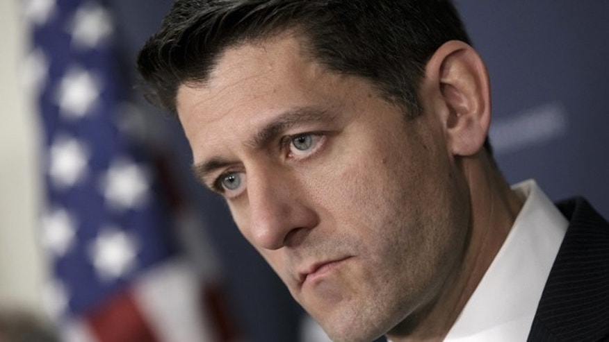 In this April 13, 2016, file photo House Speaker Paul Ryan of Wis., pauses during a news conference on Capitol Hill in Washington. Debt-ridden Puerto Rico faces a $422 million bond payment deadline May 1 with no sign Congress will act in time to help. Further complicating lawmakers' efforts to steer the U.S. territory away from economic collapse are ads airing nationwide that claim the legislation amounts to a financial bailout even though the bill has no direct financial aid. House conservatives have latched onto that argument, making it difficult for Ryan, to garner support for the bill.  (AP Photo/J. Scott Applewhite, File)