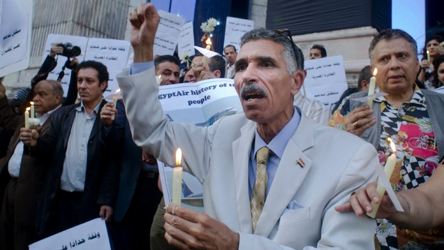 May 24, 2016: An Egyptian journalist lights candles during a candlelight vigil for the victims of EgyptAir flight 804 in front of the Journalists' Syndicate in Cairo, Egypt.