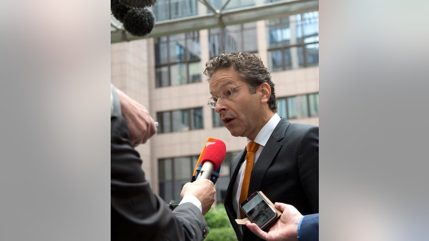Dutch Finance Minister Jeroen Dijsselbloem speaks with the media prior to a meeting of EU finance ministers in Brussels on Wednesday, May 25, 2016. Eurozone finance ministers struck a deal early Wednesday clearing the way for Greece to access a fresh round of bailout funds, while also laying out debt relief measures aimed at securing the involvement of the International Monetary Fund, or IMF. (AP Photo/Virginia Mayo)