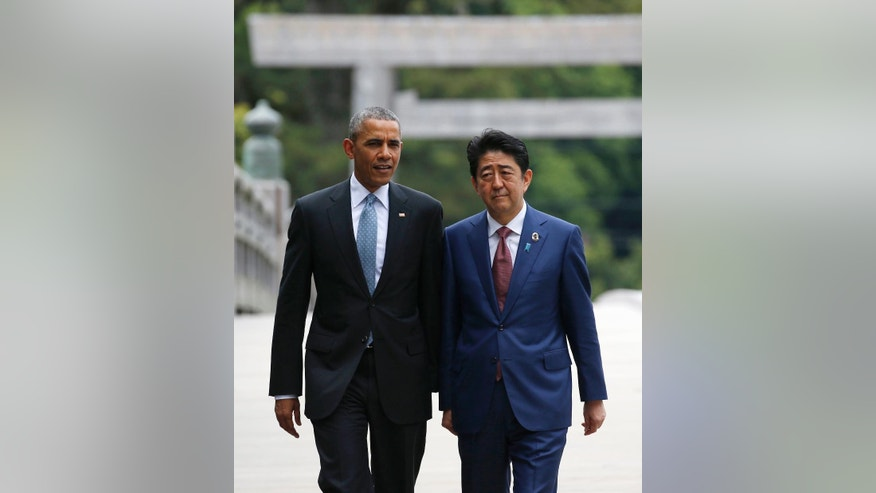 U.S. President Barack Obama, left, talks with Japanese Prime Minister Shinzo Abe, right, on the Ujibashi bridge as they visit the Ise Jingu shrine in Ise, Mie prefecture, Japan Thursday, May 26, 2016, ahead of the first session of the G7 summit meetings. The leaders of the G-7 nations have arrived for a visit at Ise Jingu, the most hallowed site for Japan's indigenous Shinto religion. (Toru Hanai/Pool Photo via AP)