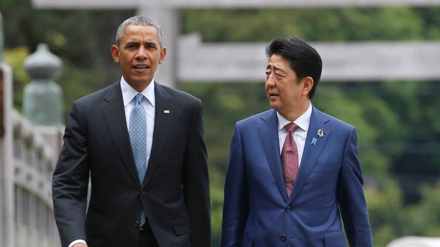 U.S. President Barack Obama, left, talks with Japanese Prime Minister Shinzo Abe on Ujibashi bridge as they visit Ise Jingu shrine in Ise, Mie prefecture, Japan Thursday, May 26, 2016, ahead of the first session of the G-7 summit meetings. The leaders of the G-7 nations have arrived for a visit at Ise Jingu, a shrine the most hallowed site for Japan's indigenous Shinto religion. (Toru Hanai/Pool Photo via AP)