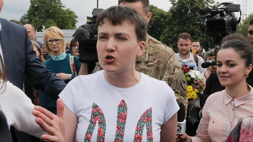 Ukrainian jailed pilot Nadezhda Savchenko speaks to the media upon her arrival at Boryspil airport outside Kiev, Ukraine, Wednesday, May 25, 2016. Russia has released jailed pilot Nadezhda Savchenko, as part of a swap for two Russian servicemen imprisoned in Ukraine. (AP Photo/Efrem Lukatsky)