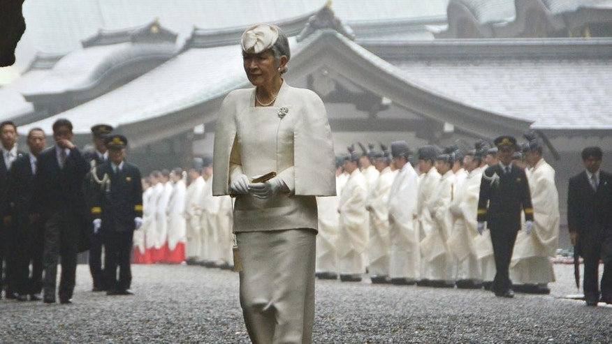 In this March 26, 2014 photo, Japan's Empress Michiko walks toward the main hall of Ise Grand Shrine, or Ise Jingu, in Ise city, central Japan. The Shinto shrine that Japanese Prime Minister Shinzo Abe is taking his Group of Seven counterparts to on Thursday, May 26, 2016, is no ordinary shrine. The Japanese imperial family was once believed to be direct descendants of the goddess Amaterasu. Rituals at Ise shrine are intended for the imperial family. (Kyodo News via AP) JAPAN OUT, MANDATORY CREDIT