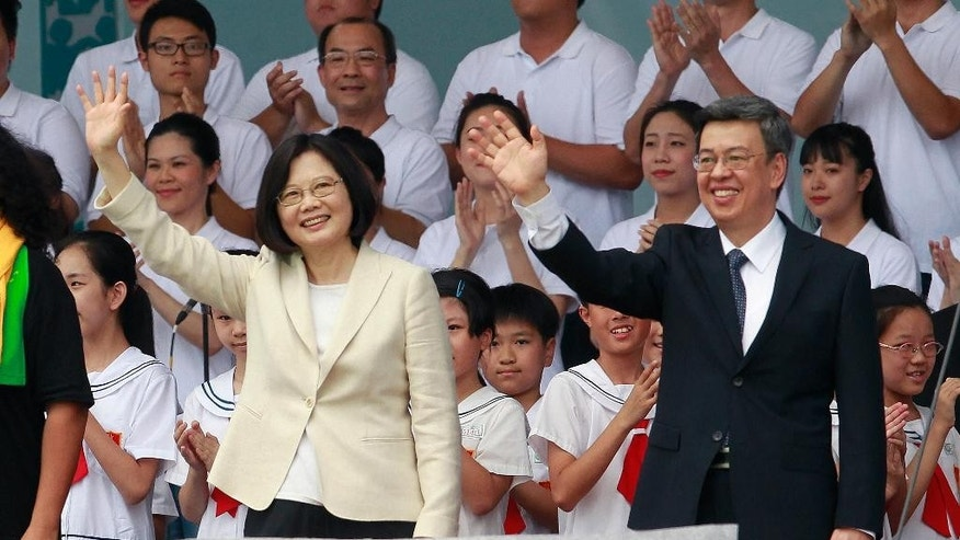 FILE - In this May 20, 2016 file photo, new Taiwan's President Tsai Ing-wen, left, and Vice President Chen Chien-jen wave during their inauguration ceremonies in Taipei, Taiwan. Taiwan's foreign minister says on Thursday, May 26, President Tsai will visit diplomatic allies Panama and Paraguay next month in her first overseas trip since taking office. (AP Photo/Chiang Ying-ying, File)