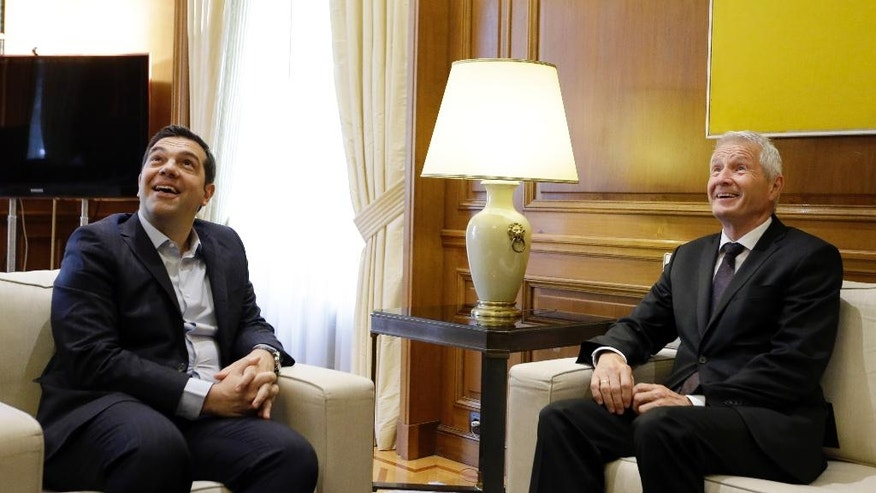 Greece's Prime Minister Alexis Tsipras, left, and Council of Europe Secretary General Thorbjorn Jagland laugh during their meeting at the Maximos Mansion in Athens, Wednesday, May 25, 2016. Jagland told The Associated Press in an interview on Wednesday, that Greece has faced major problems in dealing with the refugee crisis but that the country has made significant efforts to handle the issues, although concerns remain about the detention of some asylum-seekers while their applications are being processed. (AP Photo/Thanassis Stavrakis)