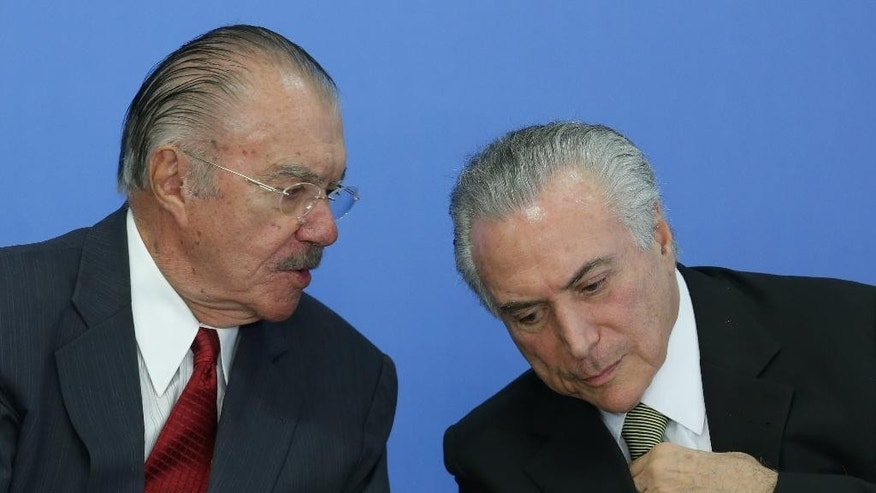 Brazil' acting President Michel Temer, right, listens to former President Jose Sarney during the swearing-in ceremony of the new Culture Minister Marcelo Calero at Planalto presidential palace in Brasilia, Brazil, Tuesday, May 24, 2016. Temer recreated the ministry after closing it, following intense protest by Brazilian artists. Temer took over after President Dilma Rousseff was impeached earlier this month for allegedly using accounting tricks in managing the federal budget. (AP Photo/Eraldo Peres)