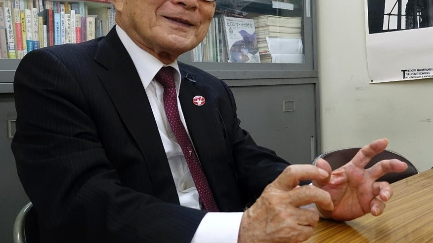 In this May 11, 2016, photo, Terumi Tanaka, secretary general of Japan Confederation of A-and H-bombs Sufferers Organizations, speaks during an exclusive interview with The Associated Press in Tokyo. The debate over whether U.S. President Barack Obama should apologize to Japanese survivors of America's atomic bombings in World War II made Tanaka think: What about his own government? Tanaka was 13 when the U.S. dropped its second atomic bomb on Nagasaki city on Aug. 9, 1945, three days after the first on Hiroshima. (AP Photo/Mari Yamaguchi)