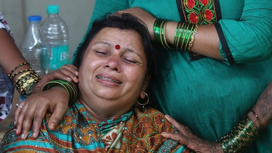 A woman grieves at a hospital after her husband sustained injuries in an explosion at a chemical factory in Dombivli, in the outskirts of Mumbai, India, Thursday, May 26, 2016. The powerful explosion shattered windows in buildings near the factory. (AP Photo/Rafiq Maqbool)