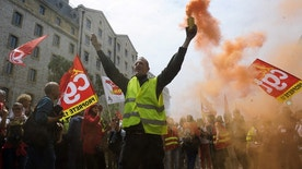 "A demonstrator burns flares and shouts slogans during a demonstration in Marseille, southern France, on a day of nationwide strikes and protests over a labor reform, Thursday, May 26, 2016. French Prime Minister Manuel Valls says he is open to ""improvements and modifications"" in a labor bill that has sparked intensifying strikes and protests, but will not abandon it. (AP Photo/Franck Pennant)"