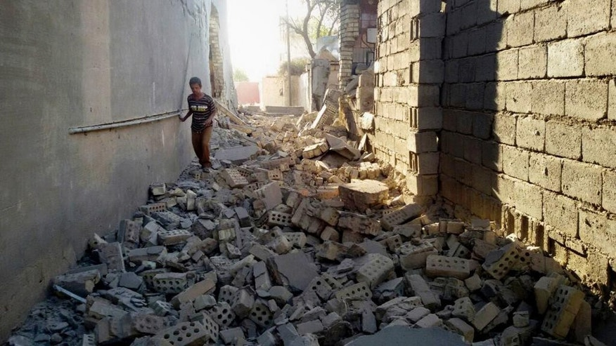 May 26, 2016: A man walks in the rubble of damaged house in Fallujah, 40 miles west of Baghdad, Iraq. ISIS is preventing people from fleeing Fallujah amid a military operation to recapture the city, a local Iraqi official and aid groups said on Wednesday.
