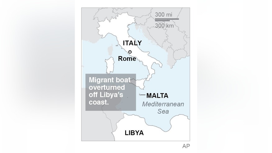 Italy's coast guard says a migrant boat has overturned off Libya's coast