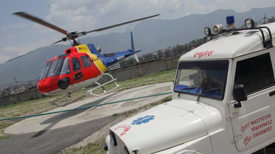 An helicopter carrying the body of Dutch climber Eric Arnold lands at Teaching hospital helipad in Kathmandu, Nepal, Thursday, May 26, 2016. Arnold died last week near South Col during a Mount Everest expedition. This year's busy climbing season follows two years of disasters that virtually emptied the mountain. (AP Photo/Niranjan Shrestha)