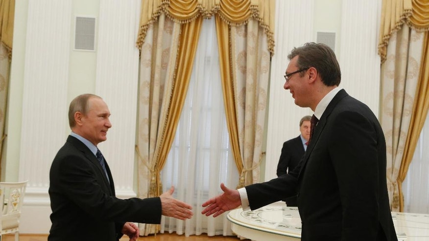 Russian President Vladimir Putin, left, greets Serbian Prime Minister and Progressive Party leader Aleksandar Vucic prior to their talks in Moscow, Russia, Thursday, May 26, 2016. (Sergei Karpukhin/Pool Photo via AP)