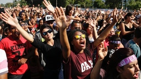 """Christians raise their hands as they sing gospel songs during the annual """"March for Jesus"""" in Sao Paulo, Brazil, Thursday, May 26, 2016. Evangelical Christians take part in the annual event that unites faithful from hundreds of Protestant churches in a country that is largely Roman Catholic. The Reborn in Christ Church has organized the march for the past 24 years. (AP Photo/Andre Penner)"""