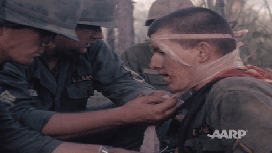 A wounded soldier receives medical attention during the battle of LZ X-Ray.