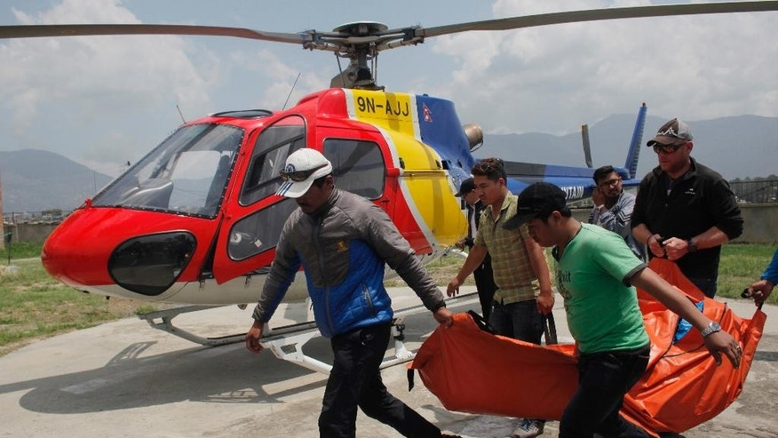 The body of Dutch climber Eric Arnold carried to Teaching hospital in Kathmandu, Nepal.