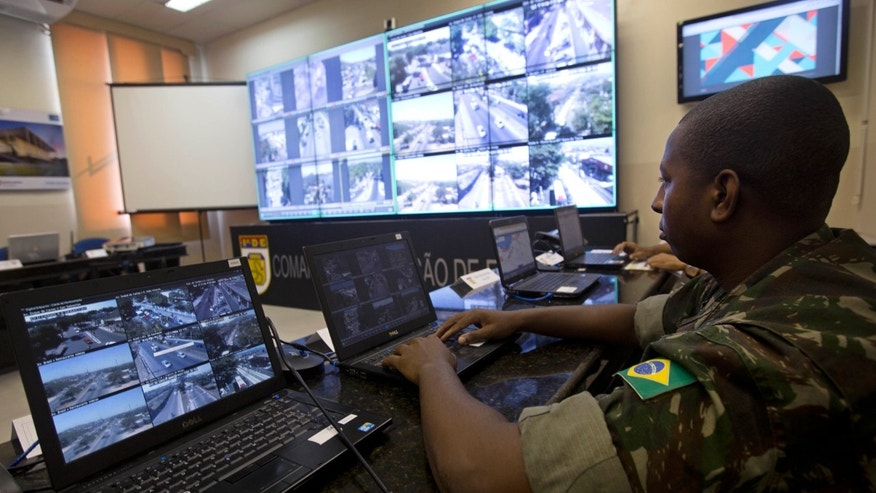April 20, 2016: a soldier watches live video showing streets near Olympic venues in Rio de Janeiro, Brazil. Rio de Janeiro's state Security Secretary Jose Mariano Beltrame said he will deploy the largest contingent of police and soldiers in Brazilian history to guard the games.