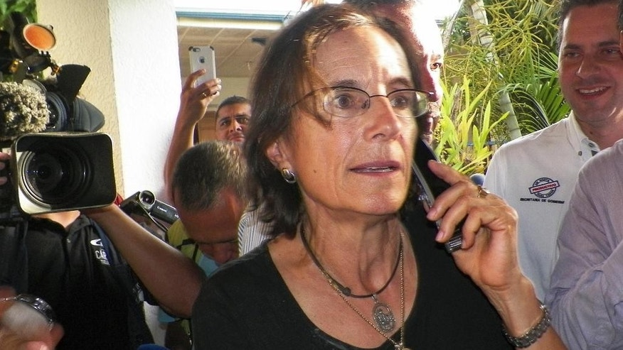 Salud Hernandez-Mora, correspondent in Colombia for Spain's El Mundo and columnist for the Bogota daily El Tiempo, speaks on the phone after being freed by leftist rebels in Ocana, northeastern Colombia, Friday, May 27, 2016. Hernandez-Mora said she was taken captive on May 21 by rebels of the National Liberation Army, ELN, while she was working on a story about coca growers in a mountainous area dominated by rebels and drug-traffickers near the border with Venezuela. (AP Photo)