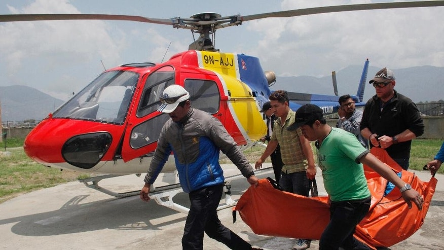 FILE - In this May 26, 2016, file photo, the body of a climber who died during a Mount Everest expedition, is carried to Teaching hospital in Kathmandu, Nepal. Nearly 300 people have died on Mt. Everest in the century or so since climbers have been trying to reach its summit. At least 100 of them are still on the mountain, perhaps 200. (AP Photo/Niranjan Shrestha, File)