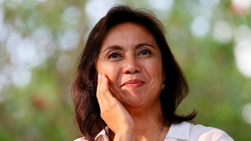 In this Sunday, May 15, 2016 photo, Vice-presidential candidate Leni Robredo prepares to address supporters after attending a thanksgiving mass for the country's peaceful elections at the Ateneo De Manila campus at suburban Quezon city northeast of Manila, Philippines. On Friday, May 27, 2016 Philippine lawmakers say Rodrigo Duterte has been elected president and Leni Robredo elected vice president in official vote count. (AP Photo/Bullit Marquez, File)
