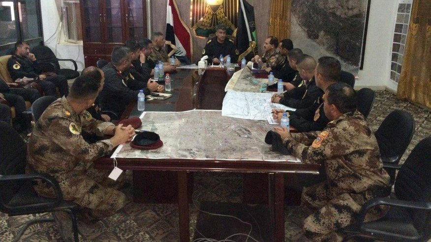 Iraqi counterterrorism officers meet at their operations center outside Fallujah, Iraq on Friday, May 27, 2016. Earlier this week, Iraqi forces launched the offensive on Fallujah. The city is located 65 kilometers (40 miles) west of Baghdad. (AP Photo/Khalid Mohammed)