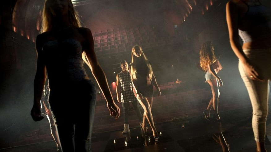 Contestants in the first Miss Trans Israel beauty pageant practice the walk on the stage during rehearsal in Tel Aviv, Israel, Thursday, May 26, 2016. The pageant will be held at HaBima, Israel's national theater, in Tel Aviv on Friday. Tel Aviv has emerged as one of the world's most LGBT-friendly travel destinations, standing in sharp contrast to most of the rest of the Middle East, where gays can face persecution. (AP Photo/Oded Balilty)