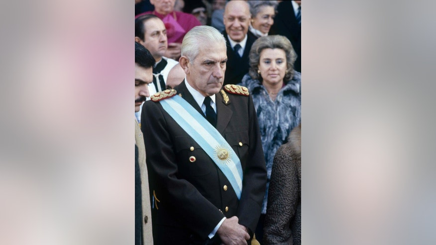 FILE - In this July 9, 1982 file photo, Argentina's last dictator, General Reynaldo Bignone, arrives for a religious ceremony at the Cathedral in Buenos Aires. A court in Argentina has sentenced the former junta leader to 20 years in prison for Operation Condor crimes. The secret conspiracy was launched by six South American dictators in the 1970s in a combined effort to track down their enemies and eliminate them. The federal court ruled Friday, May 27, 2016. Bignone is already serving life sentences for multiple human rights violations during the 1976-1983 dictatorship. (AP Photo/Eduardo Di Baia, File)