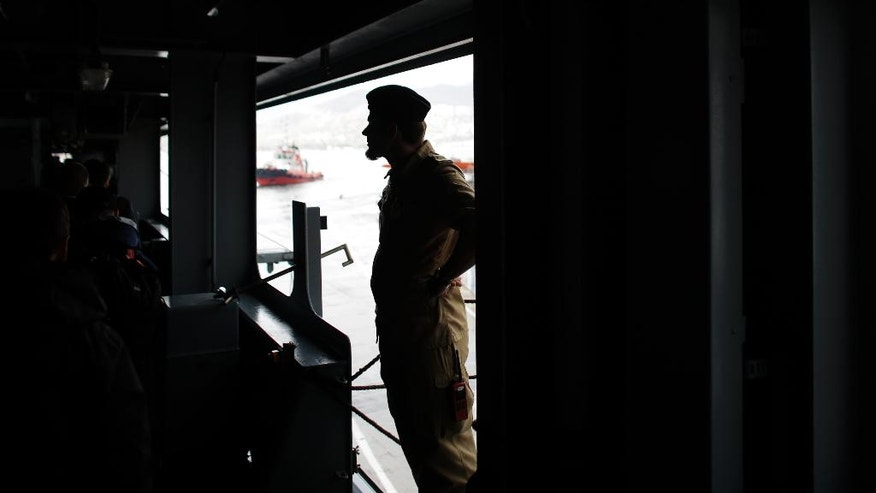 A German marine soldier stands aboard the NATO German warship FGS Bonn as the ship departs the harbour of the city of Izmir, Turkey, Thursday, May 26, 2016. The FGS Bonn is part of the NATO flotilla patrolling the Aegean Sea in an effort to curb migrant activity between Turkey and Greece. (AP Photo/Markus Schreiber)