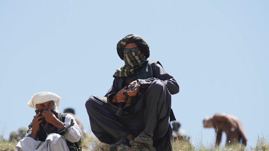 In this picture take on Friday, May 27, 2016, members of a breakaway faction of the Taliban fighters guard during a patrol in the Shindand district of Herat province, Afghanistan. Afghanistan's government has offered the new Taliban leader a choice: make peace or face the same fate as his predecessor, who was killed last week in a U.S. drone strike. (AP Photos/Allauddin Khan)