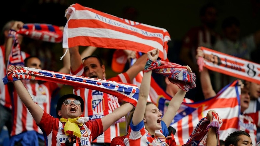 Atletico Madrid fans chant prior to the Champions League final soccer match between Real Madrid and Atletico Madrid at the San Siro stadium in Milan, Italy, Saturday, May 28, 2016.  (AP Photo/Andrew Medichini)