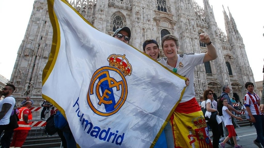 Real Madrid's supporters chant at the Duomo square, prior to the Champions League final between Atletico Madrid and Real Madrid, in Milan, Italy, Saturday, May 28, 2016. (AP Photo/Antonio Calanni)