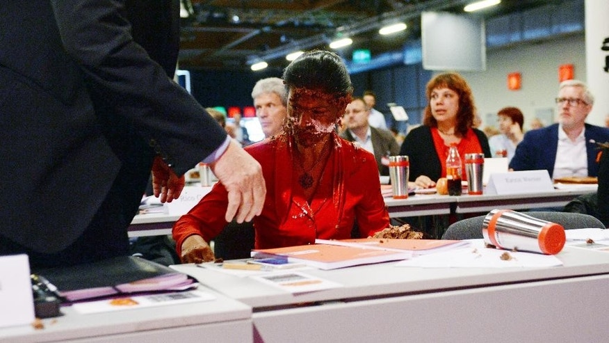 "Germany's main opposition leader Sahra Wgenknecht has her face covered with cream after activists threw a cake at her during a party congress in Magdeburg, Germany, Saturday, May 28, 2016. A group calling itself the ""Anti-Fascist Initiative 'Cake for Misanthropists'"" distributed flyers pointing to Wagenknecht's comments about refugees as the motive. (Hendrik Schmidt/dpa via AP)"