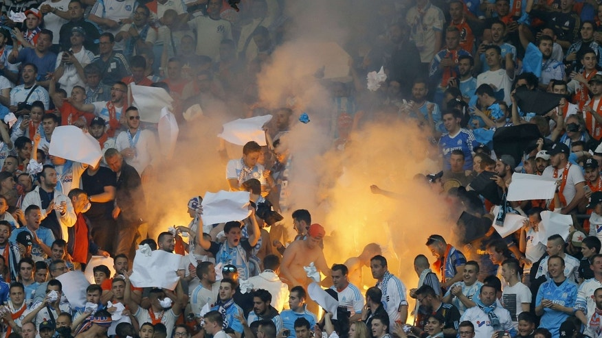 May 21, 2016: Marseille's fans light a flare during the French Cup final soccer match between Marseille and PSG at the Stade de France Stadium, in Saint Denis, North of Paris.