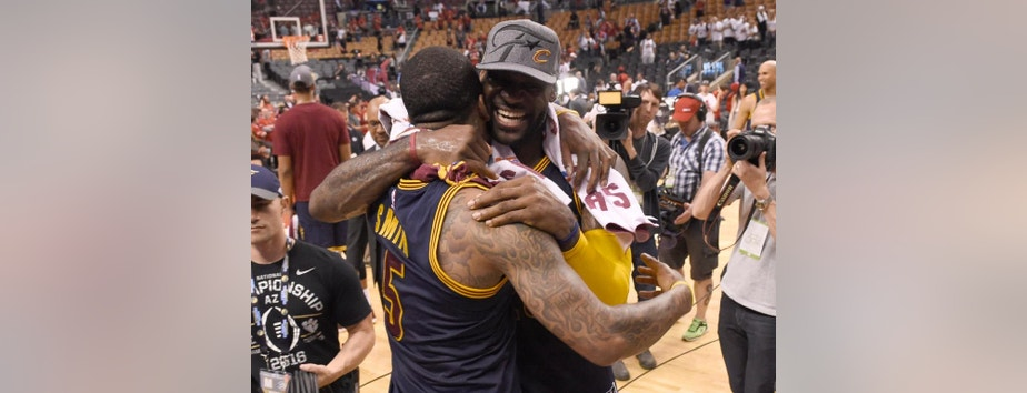 Cleveland Cavaliers forward LeBron James celebrates the team's win over the Toronto Raptors with J.R. Smith, left, after Game 6 of the NBA basketball Eastern Conference finals, Friday, May 27, 2016, in Toronto. The Cavaliers won 113-87 and advanced to the NBA Finals. (Frank Gunn/The Canadian Press via AP)