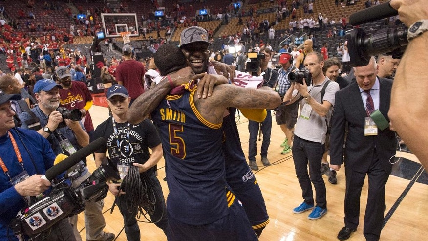 Cleveland Cavaliers forward LeBron James celebrates the team's win over the Toronto Raptors with J.R. Smith after Game 6 of the NBA basketball Eastern Conference finals, Friday, May 27, 2016, in Toronto. The Cavaliers won 113-87 and advanced to the NBA Finals. (Frank Gunn/The Canadian Press via AP)