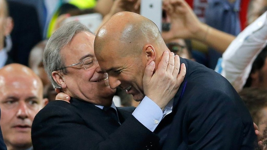 Real Madrid's headcoach Zinedine Zidane, right, is embraced by Real president Florentino Perez at the end of the Champions League final soccer match between Real Madrid and Atletico Madrid at the San Siro stadium in Milan, Italy, Saturday, May 28, 2016.  (AP Photo/Manu Fernandez)
