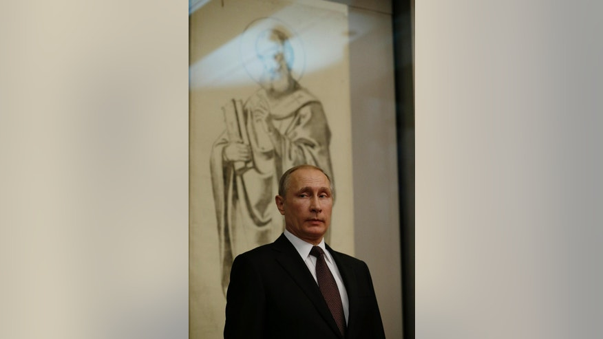 Russian President Vladimir Putin visits the Byzantine and Christian museum in Athens, Friday, May 27, 2016. Russian President Vladimir Putin has traveled to Greece to visit a secluded Christian Orthodox monastic sanctuary and discuss energy and privatization deals in the cash-strapped country. (AP Photo/Thanassis Stavrakis, Pool)