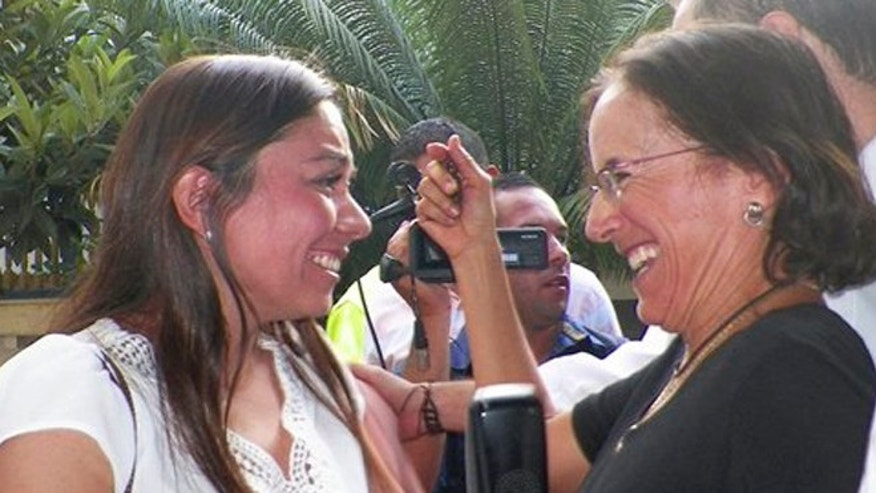 Salud Hernandez-Mora, right, correspondent in Colombia for Spain's El Mundo and columnist for the Bogota daily El Tiempo, is greeted by Melisa Gomez after Salud was freed by rebels of the National Liberation Army (ELN) in Ocana, northeastern Colombia, Friday, May 27, 2016. Gomez is the wife of Jose Cabrales Camacho, a man who was held captive by the ELN for seven months. Hernandez-Mora said she was taken captive on May 21 while working on a story about coca growers in a mountainous area dominated by rebels and drug-traffickers near the border with Venezuela. (AP Photo)