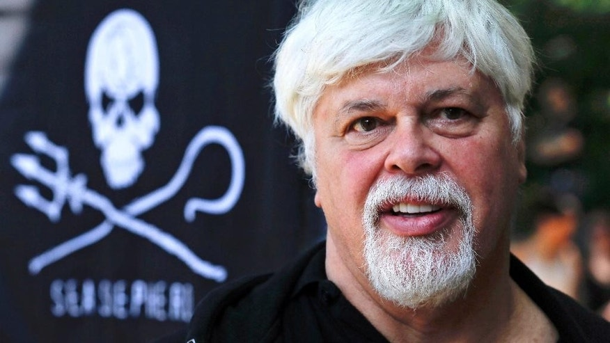 FOR STORY SLUGGED FRANCE PAUL WATSON - FILE - In this May 23, 2012 file picture Paul Watson, founder and President of the animal rights and environmental group Sea Shepherd Conservation takes part in a demonstration against the Costa Rican government near Germany's Presidential residence in Berlin, Germany, May 23, 2012.  Founder of Greenpeace and the controversial Sea Shepherd, anti-whaling activist Watson has a long history of confronting governments, and is a wanted man on Interpol's international fugitives list, but now, France has granted him political asylum. (AP Photo/Markus Schreiber, FILE)