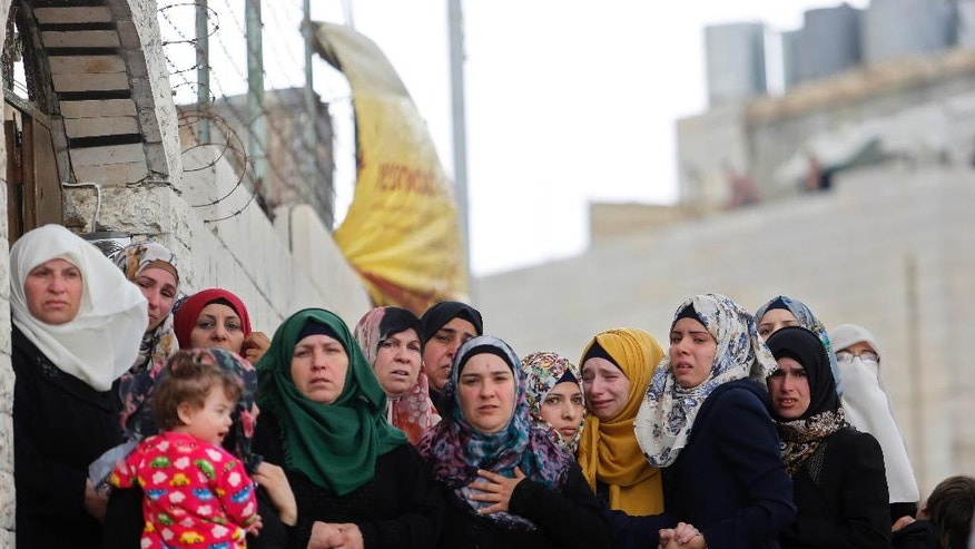 Palestinian women stand during the funeral of Abdel-Fattah al-Sharif, in the West Bank city of Hebron, Saturday ,May 28, 2016. Al-Sharif was killed by an Israeli soldier in March while lying on the ground seriously wounded after he and another Palestinian attacked IDF troops.(AP Photo/Nasser Shiyoukhi)